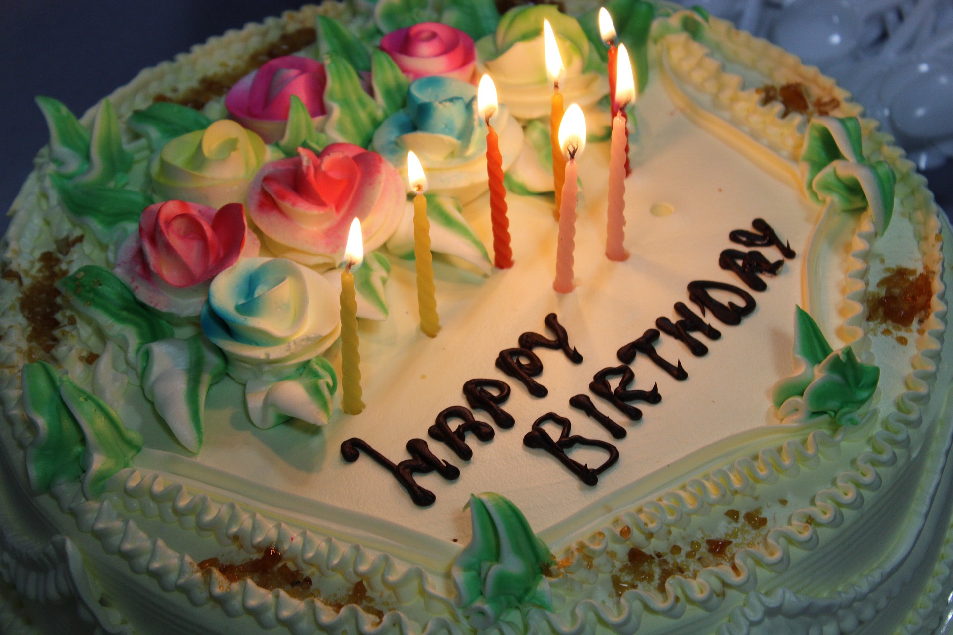 Happy Birthday! cake with multicolored candles, stock photo